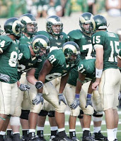 CSU football offense huddles.