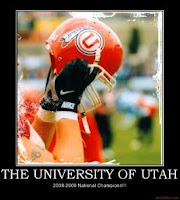 Utah football player holds up red helmet.
