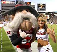 UNLV Rebels mascot with a blonde cheerleader.