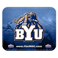Blue mountain landscape BYU cougar over school letters.