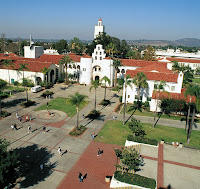 Signature white buildings with red roofs on the SDSU campus.