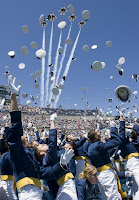 Cadets cheer at Air Force game while fighter planes go overhead.
