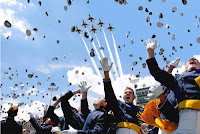 Air Force fans celebrate at a football game while planes fly over head.