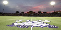 Midfield at TCU horned frogs football field under lights.