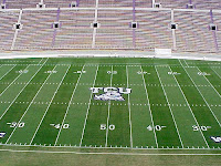 TCU football field in empty stadium.