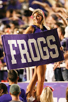 TCU cheerleader with purple Frogs sign.