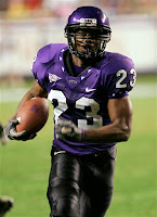 TCU football player runs with the ball.