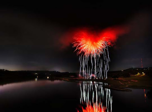 What+it+looks+like+when+fireworks+explode+inside+of+a+storm+cloud+over+a+river 60+ Jaw Dropping Examples of Fireworks Photography