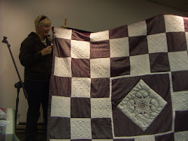 Trapunto embroidered quilt