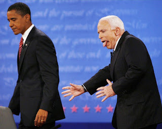 John McCain tongue out behind Barack Obama