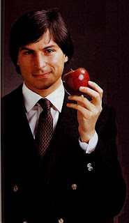 Young Steve Jobs holding an apple