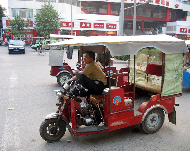 Chinese rickshaw and driver