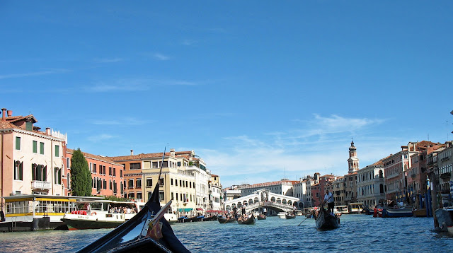 gondola with gondoliers in Venice canal