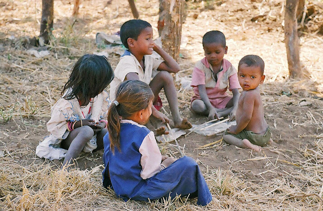children playing with sticks in rural India