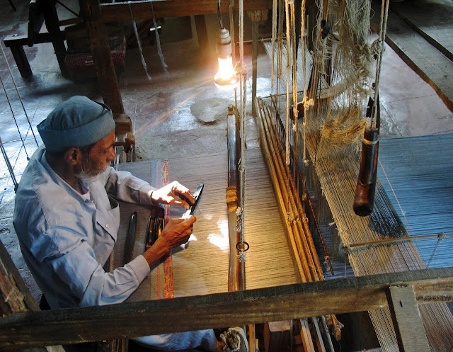 Indian weaver on manual loom