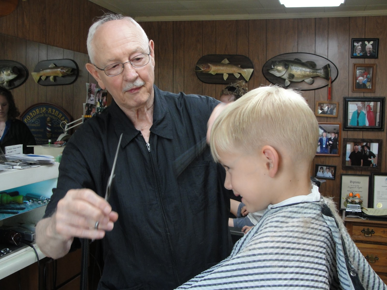 This is Gene the barber. He cuts my boys' hair, Pappy and Grandpa's