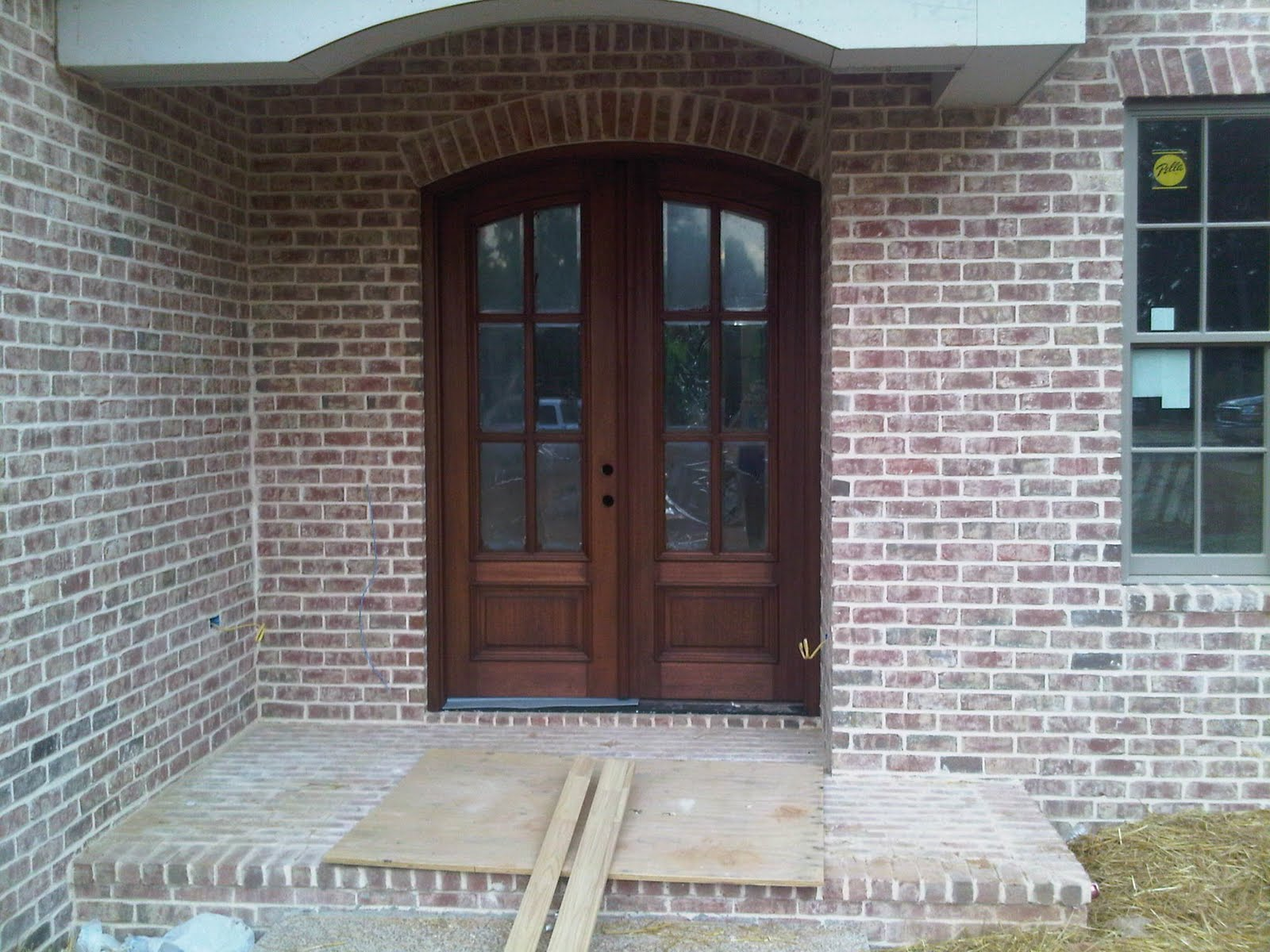 Our new home stained front door and poured back patio for Front door patio