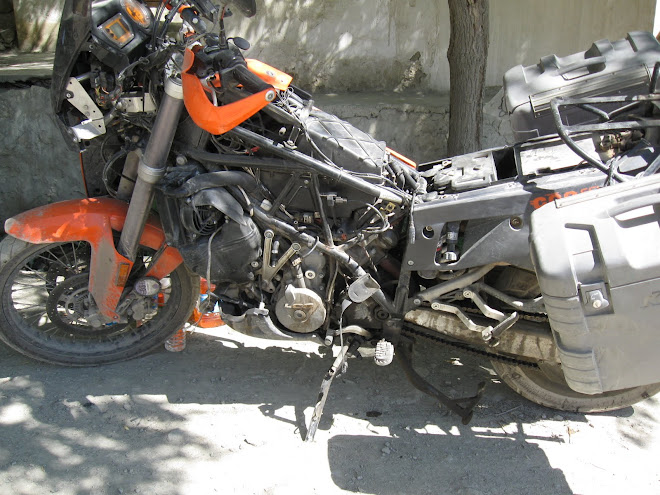 Working on the KTM on the road outside of the hotel in Mulbech