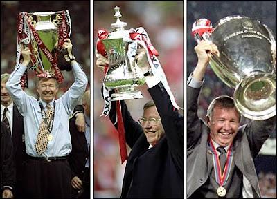 Sir Alex Ferguson lifts the Premier League trophy, the FA Cup & the European Cup