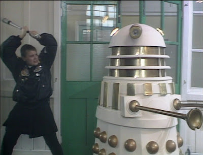 Ace attacks an Imperial Dalek with a baseball bat