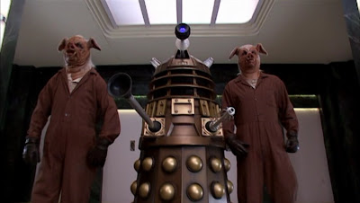 A Dalek flanked by a pair of pig slaves