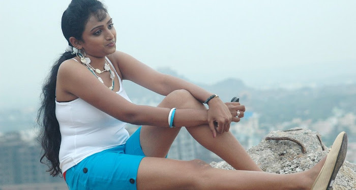 waheeda spicy in white shorts in thakita thakita cute stills