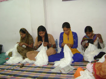 Women in SEWA Delhi sewing beads