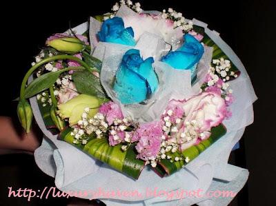 wedding anniversary blue roses bouquet