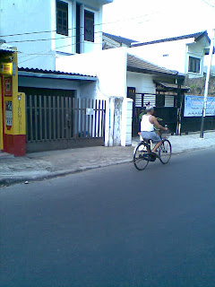 Old man bicycling in the morning