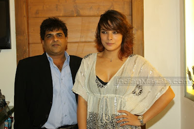 udita  goswami   is  looking  beautiful   in a  white  dress.
