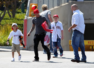 David Beckham and his family playing in the park Pictures