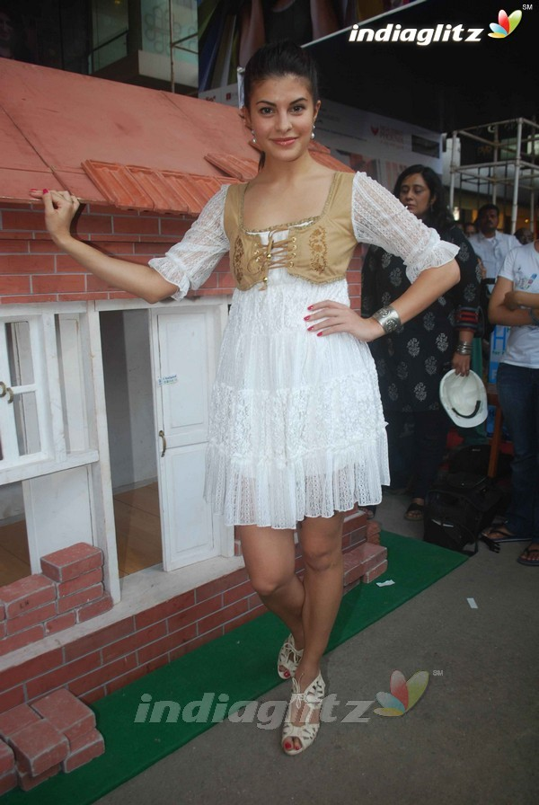 Jacqueline Fernandez in a white lace dress at a Habitat's Charity Event Mumbai