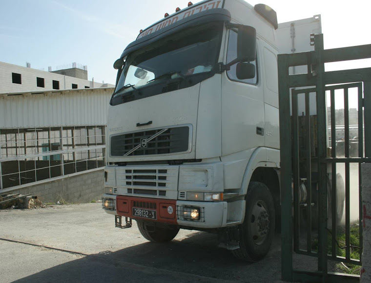 Israeli truck leaving the warehouse after the raid