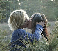 A much nicer dream pic; kissing a blond in the woods (yummy)!