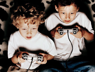 children playing video games Playstation