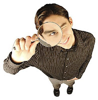 search engine postiioning, man with a magnifying glass