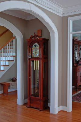 overall view of the cherry grandfather clock in the front hallway