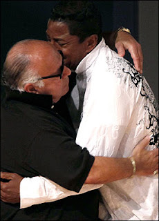 Jermaine Jackson is comforted by his pal Frank Dileo