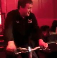 Tony G makes his entrance on a bicycle at the Big Game IV