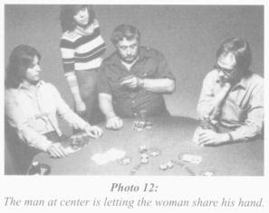 John Fox (center) in a photo from Mike Caro's 'Book of Tells'