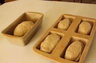 best homemade oatmeal wheat bread rising in baking stone