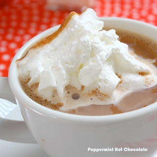 Peppermint Hot Chocolate topped with melting whipped cream
