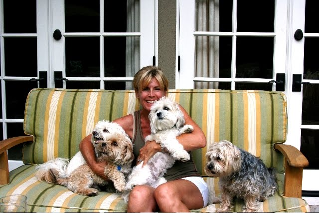 Linda Grasso of Shesez relaxing on her patio with her dogs