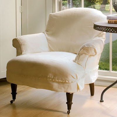 Armchair with white linen slip clover and casters from Wisteria