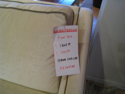 Price Tag On A Cream Colored Sofa With Piping At HD Buttercup