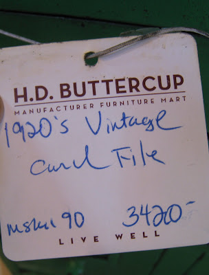 Price tag on a vintage green steel card file cabinet