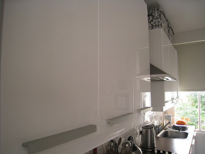 White Ikea cabinets and counters handles in a London kitchen