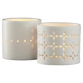 Two white eyelet porcelain candle holders from cb2