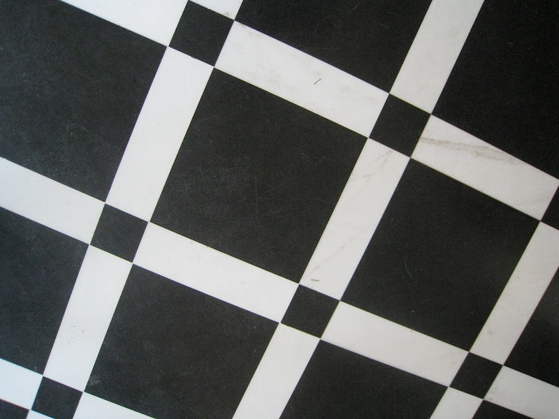 Black and white tile floor in a trellis patter in the Greystone Mansion reception hall