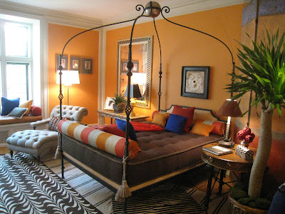 Gentelman's Atelier at the Greystone Mansion with bright orange walls and patterned rugs by James Lumsden